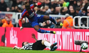 Wilfried Zaha avoids the attentions of Fabian Schar on Saturday.