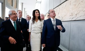 Lawyer Amal Clooney is guided by the director of the Acropolis Museum, Dimitris Pantermalis, left, during a visit with Norman Palmer (second left)