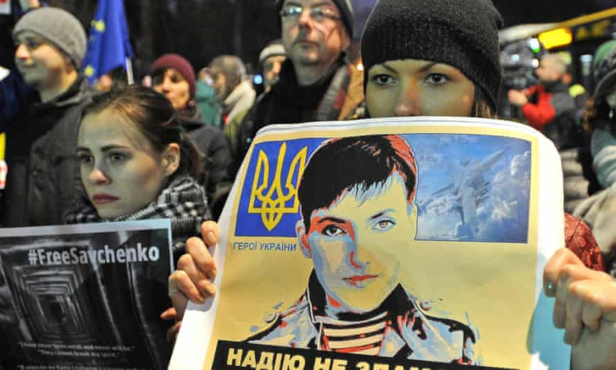 Supporters of Nadiya Savchenko hold pictures of the Ukrainian pilot during a rally outside the Russian embassy in Warsaw, Poland.