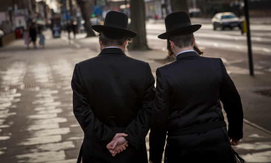 Orthodox Jewish men walking in the Stamford Hill area of London