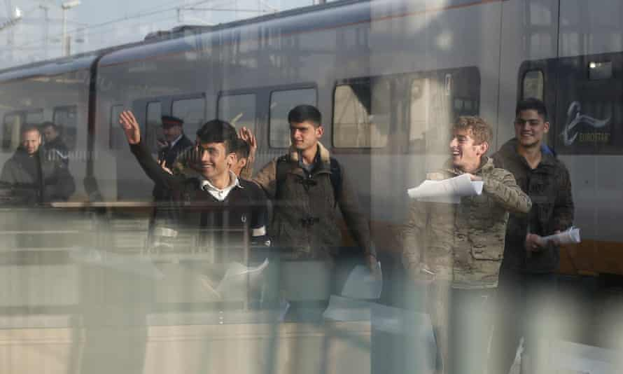 A Syrian and five Afghan boys on the platform of Calais train station, northern France, on their journey to Britain
