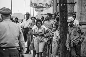 Residents gather on a street corner in Birmingham, Alabama
