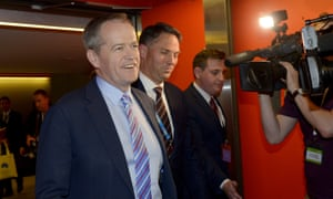 Bill Shorten and Labor immigration spokesman Richard Marles leave the conference after succeeding in the vote on asylum turnbacks.