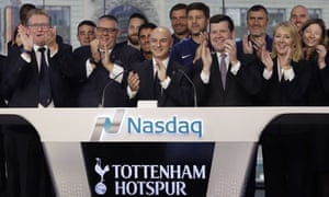 Daniel Levy, centre, and staff members of Tottenham, attend the opening bell at the Nasdaq MarketSite,  in New York