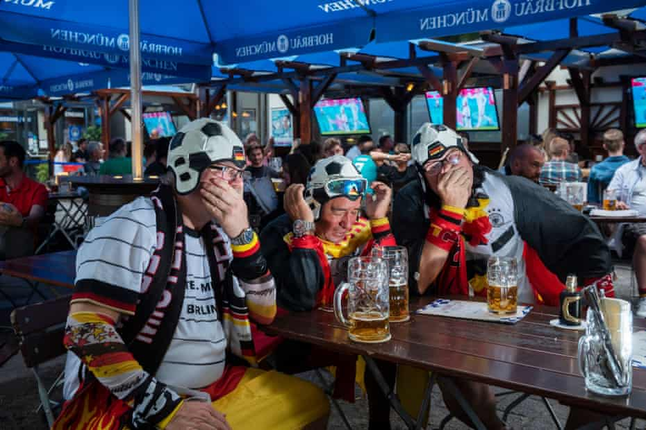Germany fans in the Hofbräuhaus on Alexanderplatz in Berlin face up to defeat