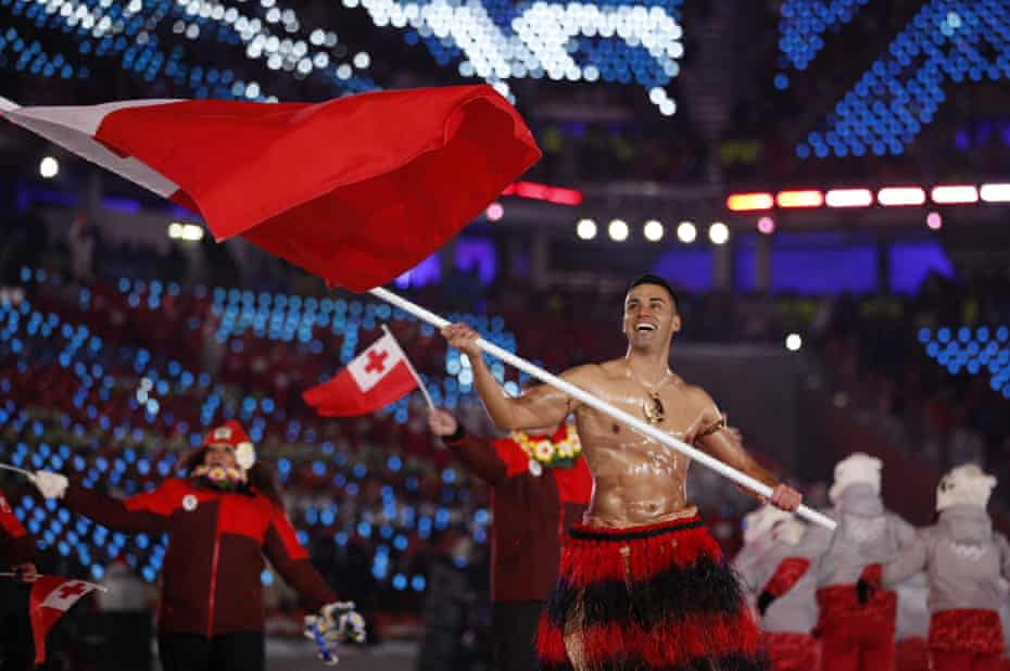 Pita Taufatofua carries the Tongan flag during the 2018 Winter Olympics opening ceremony in Pyeongchang, South Korea.