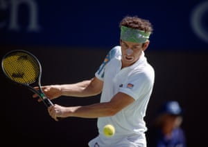 Dressed for the heat, John McEnroe returns a ball in the 1990 edition.