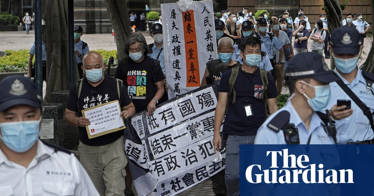 Hong Kong police out in force to deter protests on China's national day – The Guardian