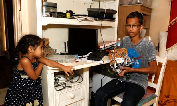 Ahmed Mohamed, 14, poses with some of his other electronics with his three-year-old sister, Fatima Mohamed, left, in their home in Irving, Texas, on Wednesday. Photograph: David Woo/Dallas Morning News/Corbis
