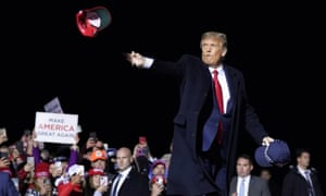 Donald Trump throwing MAGA baseball caps into the crowd at a campaign rally at Duluth International airport, Minnesota, 30 September 2020