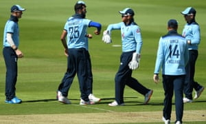 Saqib Mahmood of England celebrates the wicket of Harry Tector of Ireland with Jonny Bairstow and teammates.