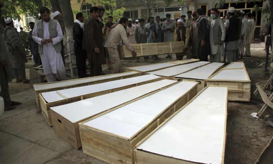 The coffins of the victims of Tuesday's attack are placed on the ground at a hospital in northern Baghlan province, Afghanistan
