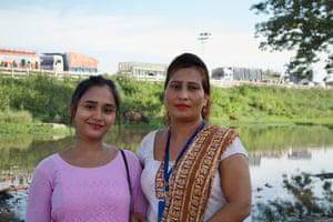 Interceptors Asmita Thapa and Maya Gurung, standing at the crossing point into India, Nepal