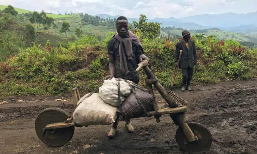 Travellers on muddy road in DRC.