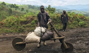 Travellers on the road in Masisi in the Democratic Republic of Congo.