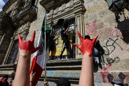 Demonstrators protest outside of Jalisco State Government Palace to demand justice for Giovanni Lopez, a construction worker who died after being arrested for not wearing a face mask in public.