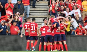 United players celebrate after scoring during the FFA Cup Final match between Adelaide United and Sydney FC.
