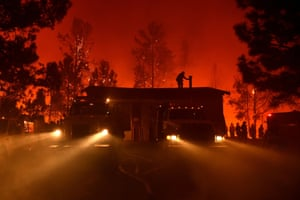 Firefighters attempt to save the Casa Loma fire station in the Santa Cruz Mountains in California