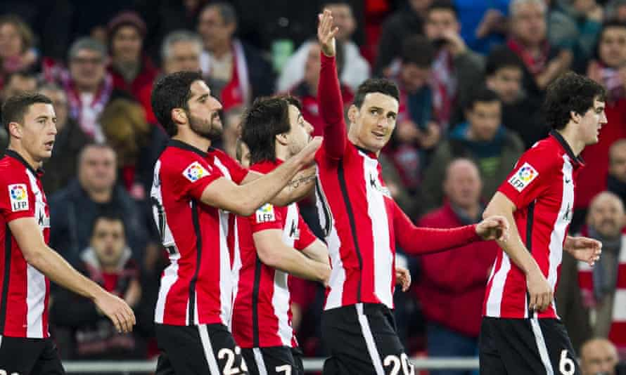 Aritz Aduriz celebrates with his team-mates after completing his hat-trick.