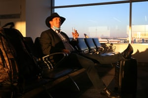 Alistair Percy enjoys a glass of bubbly in Sydney as he waits to board Air New Zealand flight 246 for Wellington.