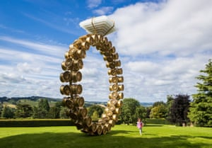Wakefield, UK A young visitor runs past a work titled Solitaire, a seven-metre-high ring made of golden car wheel rims topped with a huge diamond crafted from crystal whisky glasses, by the Portugese artist Joana Vasconcelos, as the Yorkshire sculpture park reopens