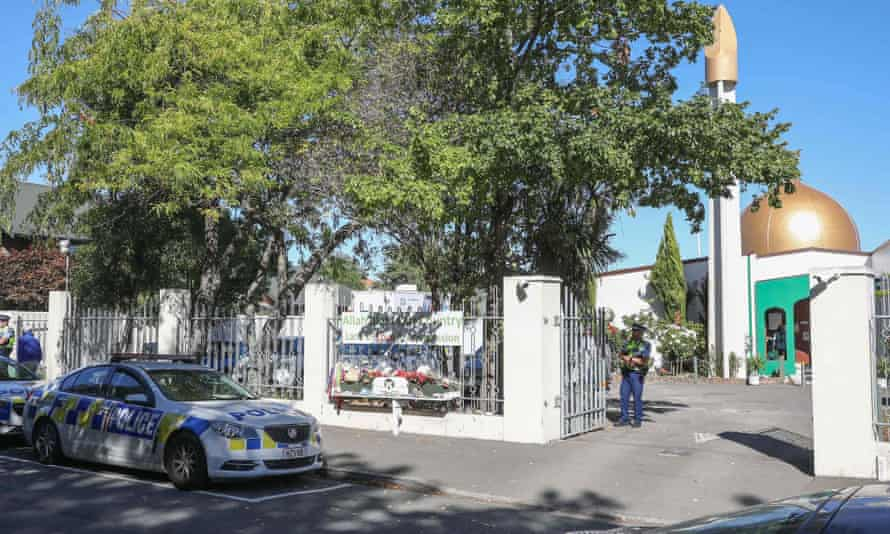 police vehicles parked outside Al Noor Mosque in Christchurch