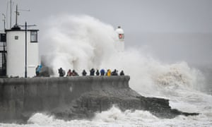 Rough seas pound against the harbour wall at Porthcawl, Wales.