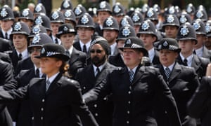 Newly qualified police officers at their passing out parade in 2012. The number of uniformed frontline officers has fallen by 19,668 since 2010.