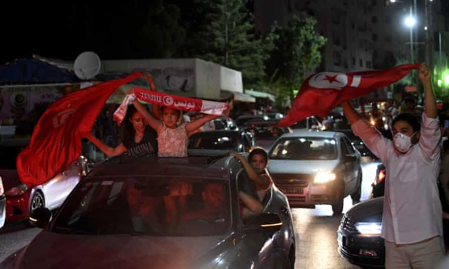 Cheering crowds in Tunis.