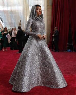 Janelle Monae in a metallic hooded Ralph Lauren dress