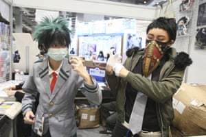 Taipei, Taiwan: visitors wear facemasks at the annual comic convention