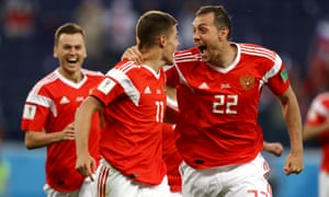 Russia, who have won their first two World Cup matches, celebrate their opening goal against Egypt.