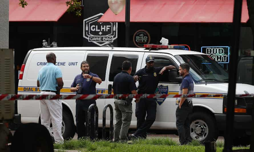 Officials investigate the shooting at GLHF Game Bar, where the tournament was livestreamed on Twitch, on 27 August.