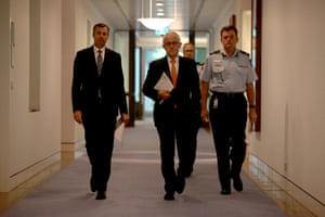 Malcolm Turnbull, justice minister Michael Keenan and AFP commissioner Andrew Colvin arrive for a press conference.