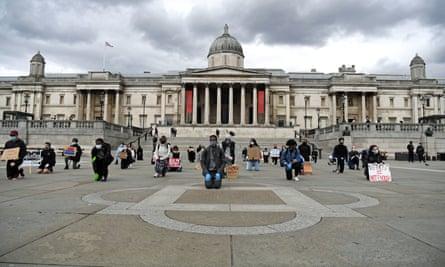 People kneeling at an anti-racism protest in Trafalgar Square, London, on 5 June 2020