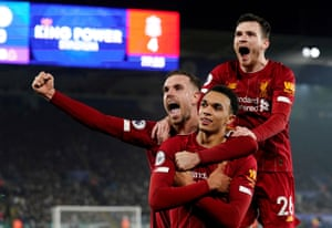 Trent Alexander-Arnold celebrates his goal with Jordan Henderson and Andrew Robertson.