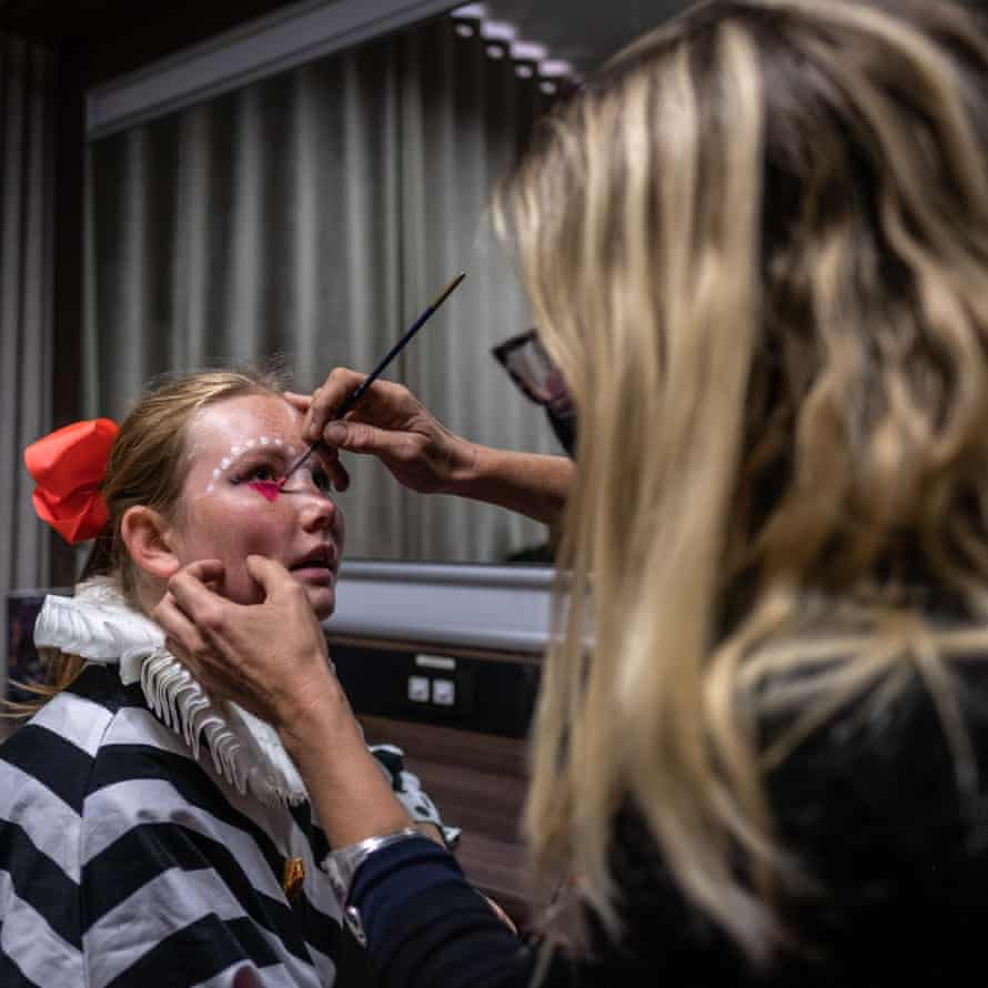Emilie van den Hooyen, a performer and student at the College of Magic, has her face painted before a performance at the Artscape theatre centre.