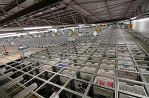 """Bots"" are seen operating on Ocado's ""smart platform"" at the its customer fulfilment centre in Andover."