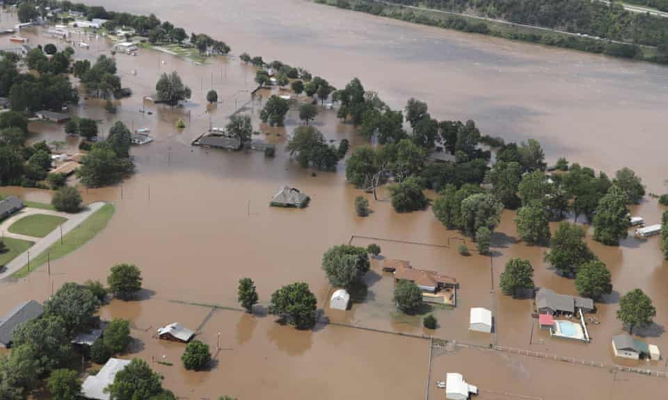 Homes are inundated with flood waters from the Arkansas river in Sand Springs, Oklahoma.