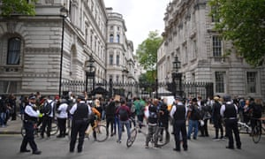 Demonstrators hold placards during a Stand up to Racism protest outside of Downing Street on 9 June 2020