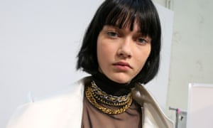Chunky gold chains in the Sacai show for Paris Fashion Week.