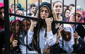 Women react during the funeral of a victim of the failed coup in Istanbul