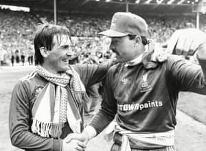 Liverpool player/manager Kenny Dalglish congratulates goalkeeper Bruce Grobbelaar after winning the 1986 FA Cup.