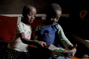 Jackline's younger sisters Faith Nyakerario, 5, and Maurine Bochaderi, 7, study together at their home in Lindi.