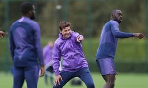 Mauricio Pochettino laughs during Tottenham training