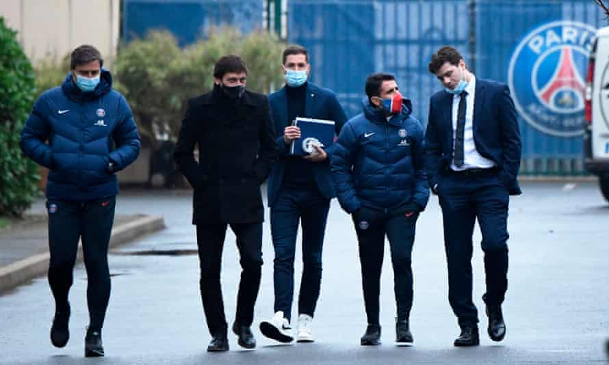 Mauricio Pochettino (right) walks with Paris Saint-Germain's sporting director Leonardo (second-left) and staff members as he leaves after a training session and his official presentation at the team's training facility in Saint-Germain-en-Laye.