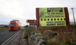 Traffic crosses the border into Northern Ireland from the Irish Republic alongside an anti-Brexit Border poster on the Dublin road Co Armagh border, between Newry in Northern Ireland and Dundalk in Ireland