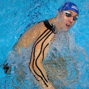 Belarus' Ilya Shymanovich of the Energy Standard team, practices his breaststroke despite being heavily strapped up