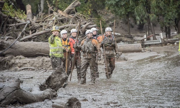 Rescuers working together after the massive mudslide in southern California