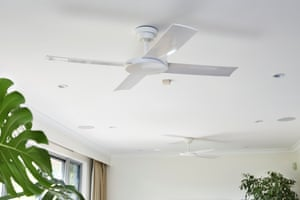 A ceiling fan will cool you down, but is far lower-energy than air conditioning.